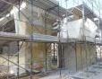 Redazionale: Rockwool per l'ingresso di Expo Milano 2015 - Il sistema Redart di Rockwool impiegato per l'isolamento a cappotto della facciata della palazzina in cemento armato e mattoni situata all'ingresso di Expo, a Porta Triulza